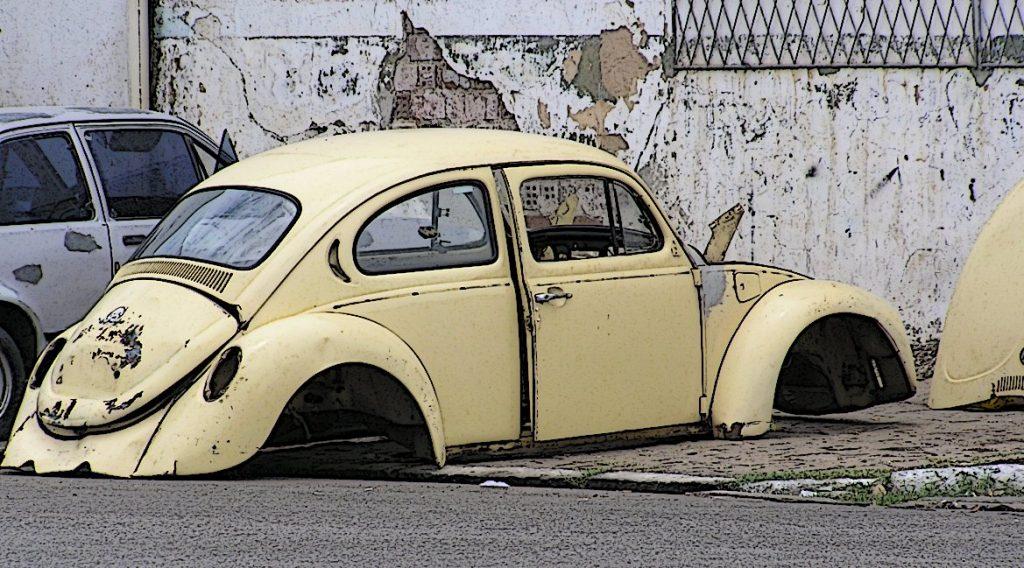 Bild eines verrosteten VW Käfer